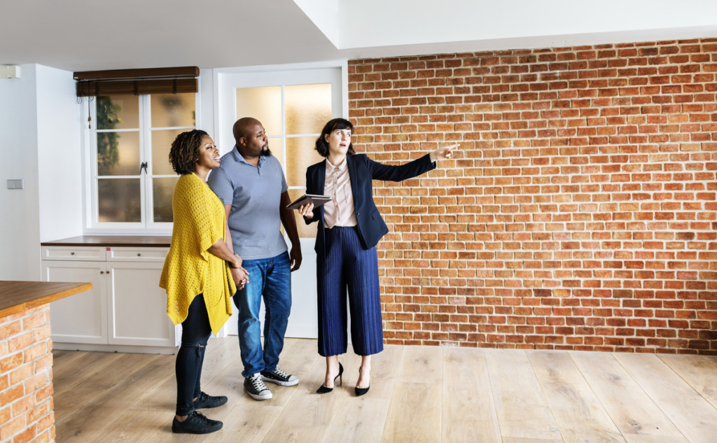 black family touring a house to buy racial homeownership gap discrimination