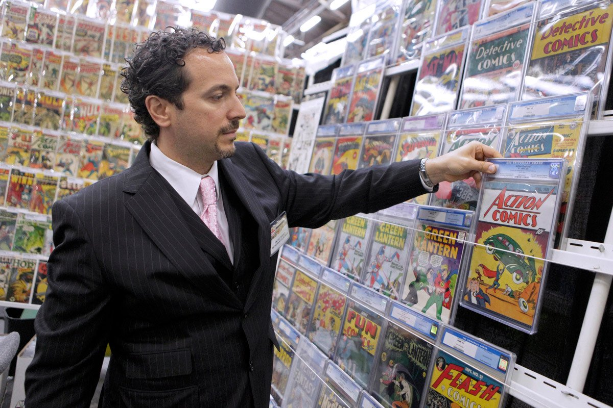 A man looks at a Superman comic at his comic book store in NYC.