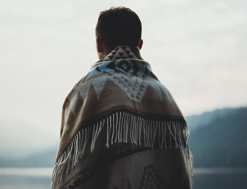 person standing outside in a poncho
